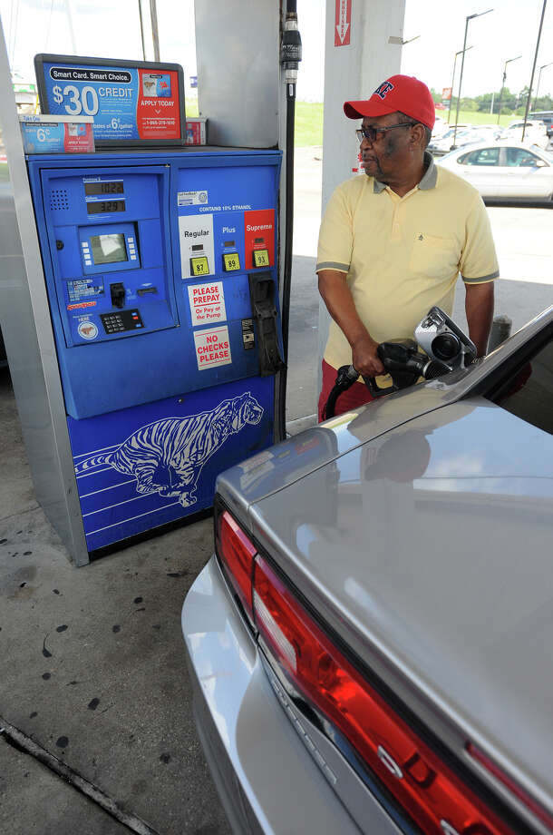 Preston Walker pumps gas Monday at the Fisco on Folsom and Texas 69. Gas prices are nearing the three dollar mark.  Photo taken Monday, September 15, 2014 Guiseppe Barranco/@spotnewsshooter Photo: Guiseppe Barranco, Photo Editor