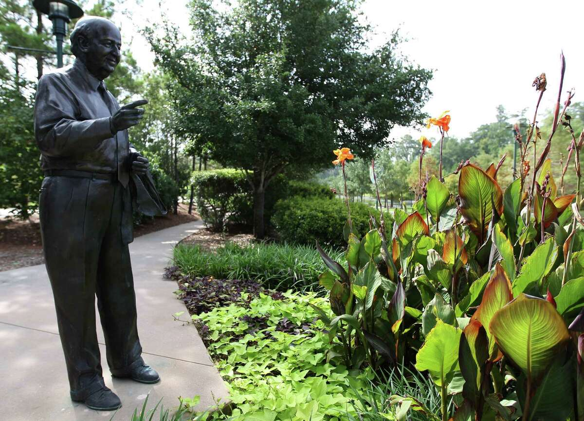 A statue of The Woodlands founder George Mitchell watches over Town Green Park. Mitchell died in July 2013 at the age of 94.
