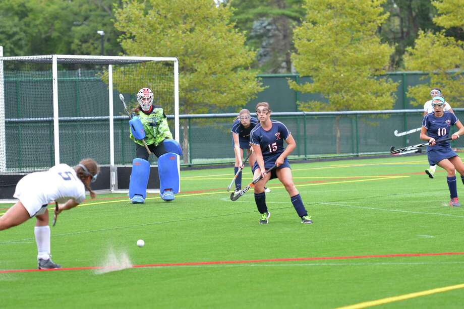 GFA goalie Jenny Ross looks on while a Rye Country Day player fires a shot during a game last week. Ross made 23 saves in a 6-0 defeat. Ross was supported by defenders, from left, Lily McGonagle, Nicole Litt and Juliet Fontana. Photo: Contributed Photo / Westport News Contributed