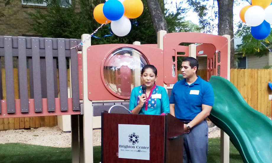 Kosha and Tim Vriseno talk during a ceremony  at Brighton Center's new Monte Vista campus. Two of the Vriseno's children have received assistance at the school that helps youngsters with developmental challenges. Photo: Photos By Edmond Ortiz / Alamo Heights Weekly