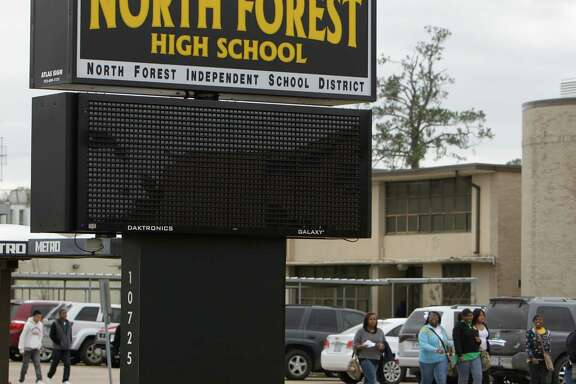 HISD is seeking more state funds to rebuild North Forest High School, shown here during a shooting investigation in 2012. HISD annexed the North Forest school district 14 months ago. ( Melissa Phillip / Houston Chronicle )