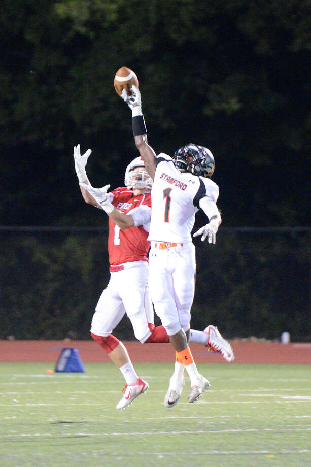 Fairfield's Jake Buckley pulls down a pass, then runs for a touchdown as Stamford High School challenges Fairfield Prep at Fairfield Ludlowe High School in high school varsity football action on Thurs. Sept. 11, 2014. Photo: Shelley Cryan / Stamford Advocate freelance/Shelley Cryan