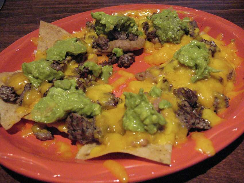Super nachos: But none of that weak sauce like you would find at Taco Bell. This must be full on nachos with loads of melted cheese with gobs of gauc, jalapenos and no ground beef. Steak or chicken only.