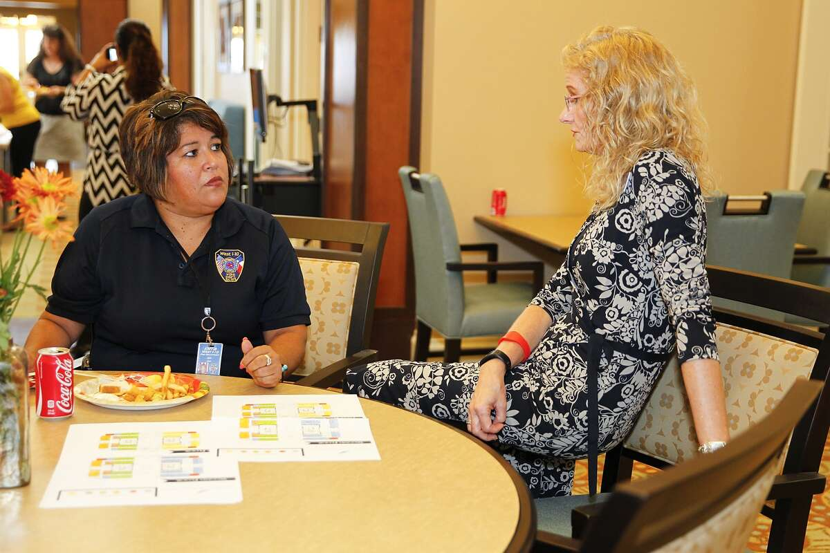 First responder Monica Atherton, left, talks with Diana Saufley, community relations director at the Legacy at Falcon Point Assisted Living and Memory Center in Katy, during a meet-and-greet and facility tour on Sept. 11, before the facility opens later this fall.
