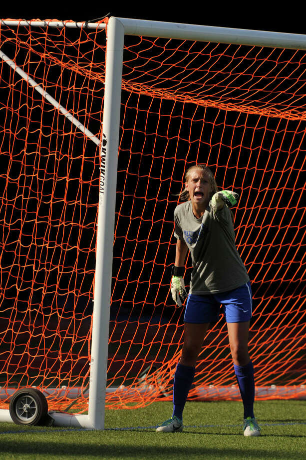 Darien goalie Kate Fiore shouts commands to her defense during the Blue Wave's soccer game against Greenwich at Greenwich High School on Wednesday, Sept. 10. Photo: Jason Rearick / Stamford Advocate