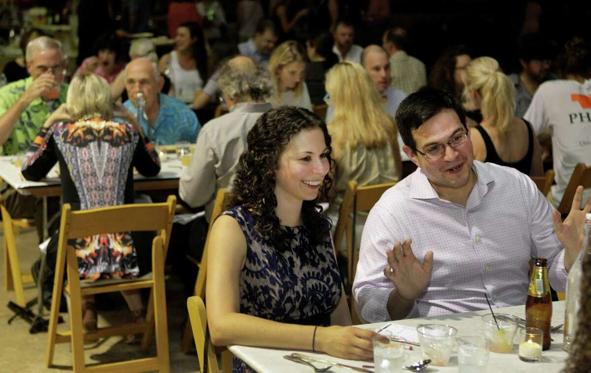 Melissa Bazan, left, and Joshua Layton are among those who participated in the first Dinner Lab dinner in Houston.