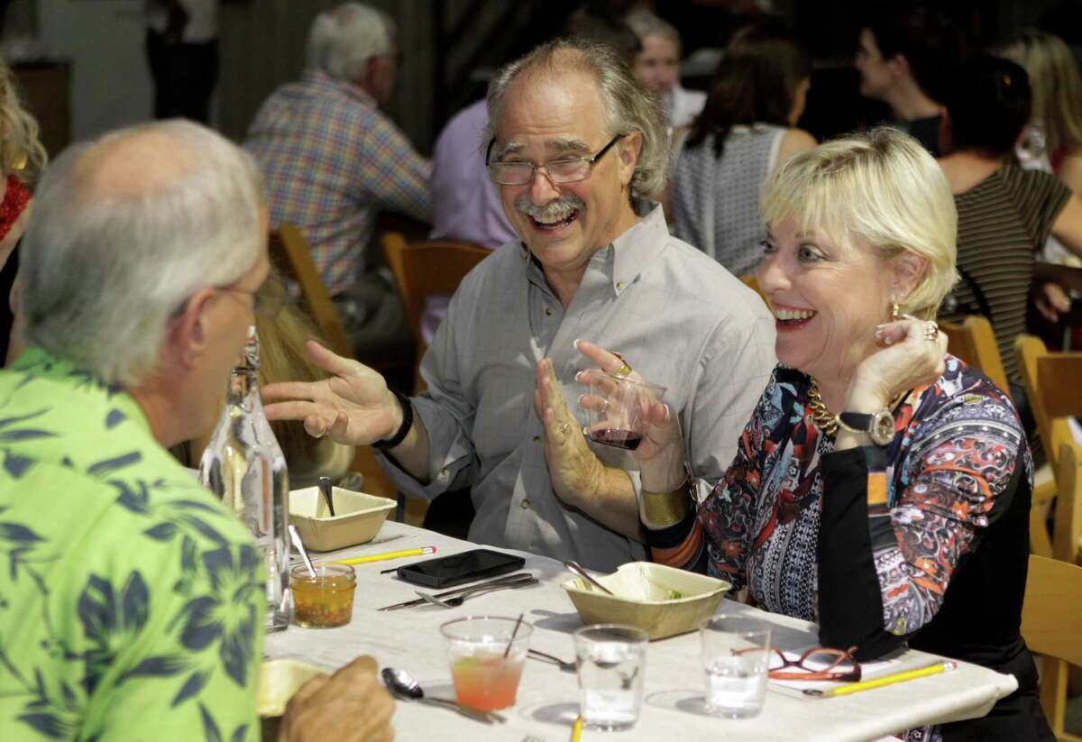 Diners Bruce Wiley, left, Andy Diraddo, center, and Terri Diraddo, right, are shown during Dinner Lab held at Makerspace, 100 Hutcheson St., Friday, Sept. 5, 2014, in Houston. ( Melissa Phillip / Houston Chronicle )