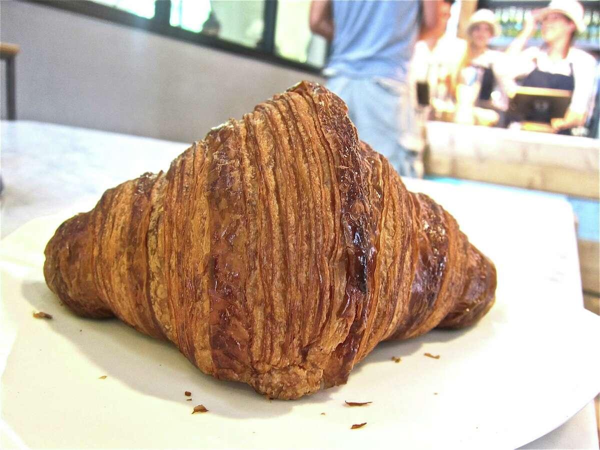 A plain croissant at Common Bond Cafe & Bakery.
