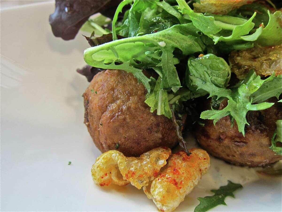 Fried boudin balls with remoulade, greens and cracklinsat Common Bond Cafe & Bakery.