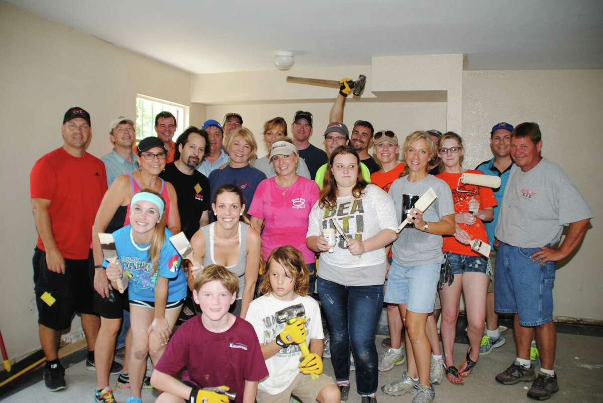 Volunteers, led by the Custom Builders Council of the Greater Houston Builders Association, get ready to pitch in on the renovation of the multipurpose room in Santa Maria Hostel's Jacquelyn House.