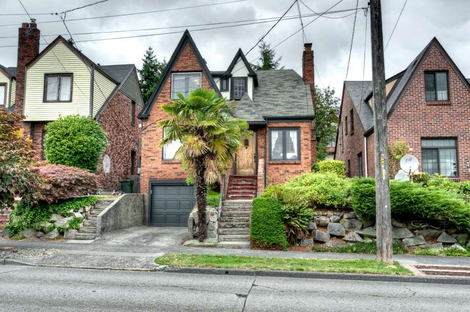 We'll start with the oldest house on our tour, 1018 N.E. 80th St., which was built in 1929. It's 2,500 square feet, with three bedrooms, a bathroom, a powder room, leaded glass, coved ceilings and picture rail on a 2,720-square-foot lot. It's listed for $479,000. Photo: Courtesy Roger Turner And Andrew Fortier/Windermere Real Estate Co.