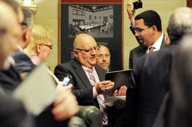 Gloversville High Latin teacher Charles Giglio, center, accepts New York State Teacher of the Year award from State Education Commissioner John B. King, Jr., right, on Tuesday, Sept. 16, 2014, at the State Education Building in Albany, N.Y. (Cindy Schultz / Times Union) Photo: Cindy Schultz / 10028644A