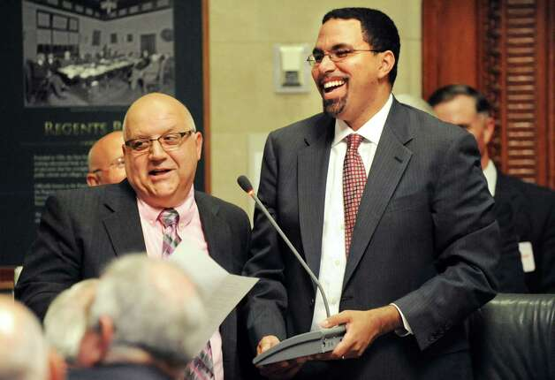 Gloversville High Latin teacher Charles Giglio, left, speaks after receiving the New York State Teacher of the Year award from State Education Commissioner John B. King, Jr., right, on Tuesday, Sept. 16, 2014, at the State Education Building in Albany, N.Y. (Cindy Schultz / Times Union) Photo: Cindy Schultz / 10028644A