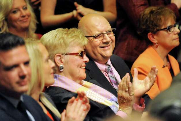 Gloversville High Latin teacher Charles Giglio, center, sits with his wife, Patricia Giglio, before receiving the New York State Teacher of the Year award on Tuesday, Sept. 16, 2014, at the State Education Building in Albany, N.Y. (Cindy Schultz / Times Union) Photo: Cindy Schultz / 10028644A