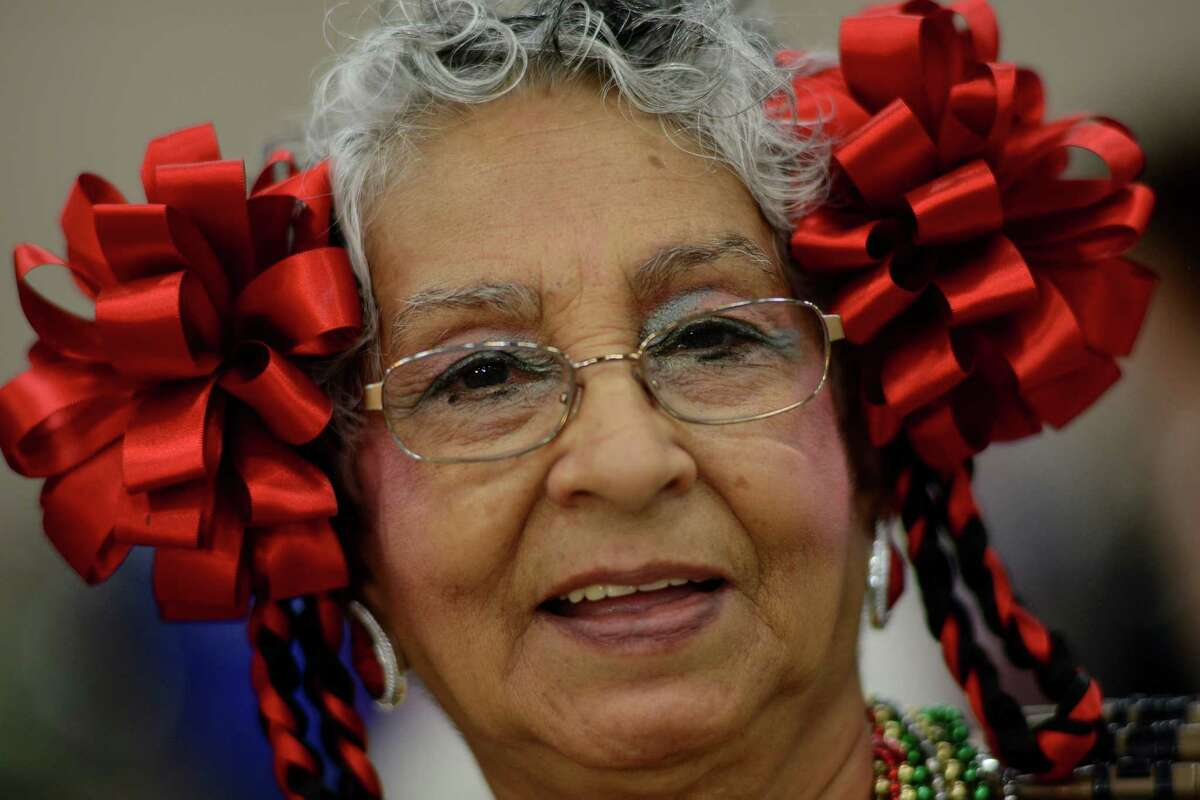 Gamelia Watts, 77, wears bows during the Senior Kermes, celebrating Mexico's Independence Day holiday of Diez y Seis de Septiembre, at the Henry B. Gonzalez Convention Center on Tuesday, Sept. 16, 2014. The event was open to the elderly enrolled in the city's senior centers and nutrition sites.