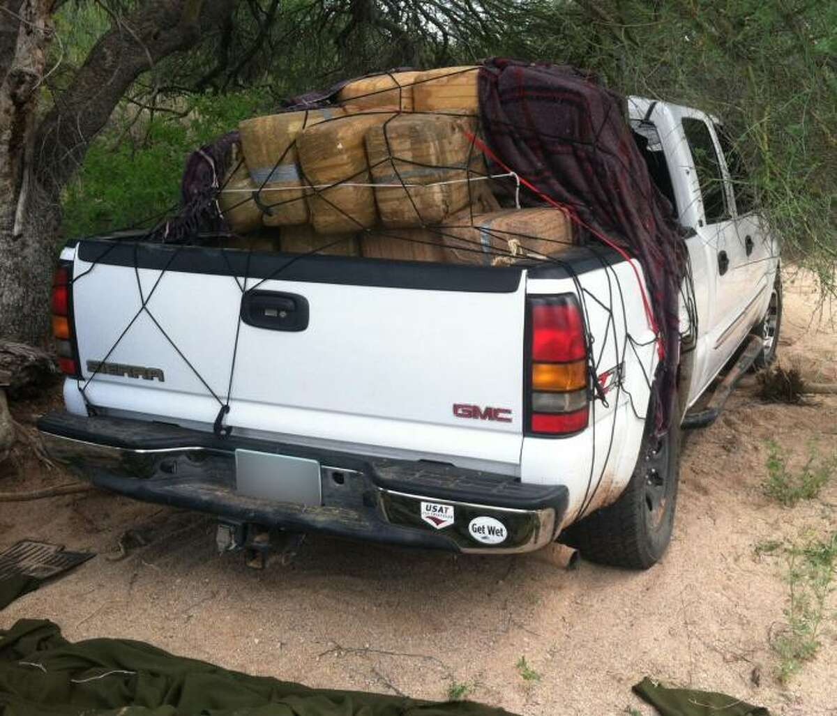 Tucson Sector Border Patrol agents seized more than 1,700 pounds of marijuana worth $878,500 from a stolen vehicle near Why, Arizona on Sept. 9, 2014. Agents from the Ajo Border Patrol Station discovered and followed a set of tire tracks leading them an abandoned pick-up truck covered with a large green tarp attempting to conceal 81 bundles of marijuana.