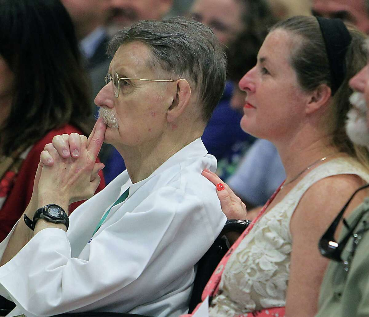 """Dr. James H. """"Red"""" Duke and his daughter Sara Duke observe the dedication ceremony at Dr. James """"Red"""" Duke Elementary School in Manvel. """"I don't know what I did to warrant this honor,"""" he says. """"I'm deeply touched."""""""