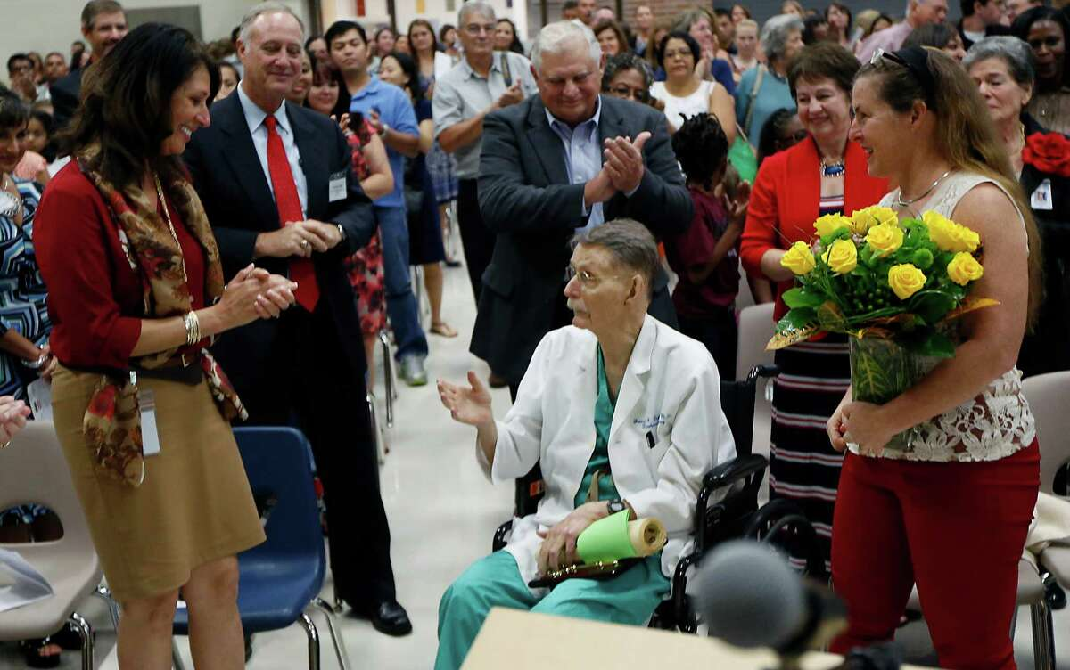 """Dr. James H. """"Red"""" Duke is applauded at the dedication of the school named for him. """"I don't know what I did to warrant this honor,"""" he says. Dr. James H. """"Red"""" Duke is applauded at the dedication of the school named for him. """"I don't know what I did to warrant this honor,"""" he says."""