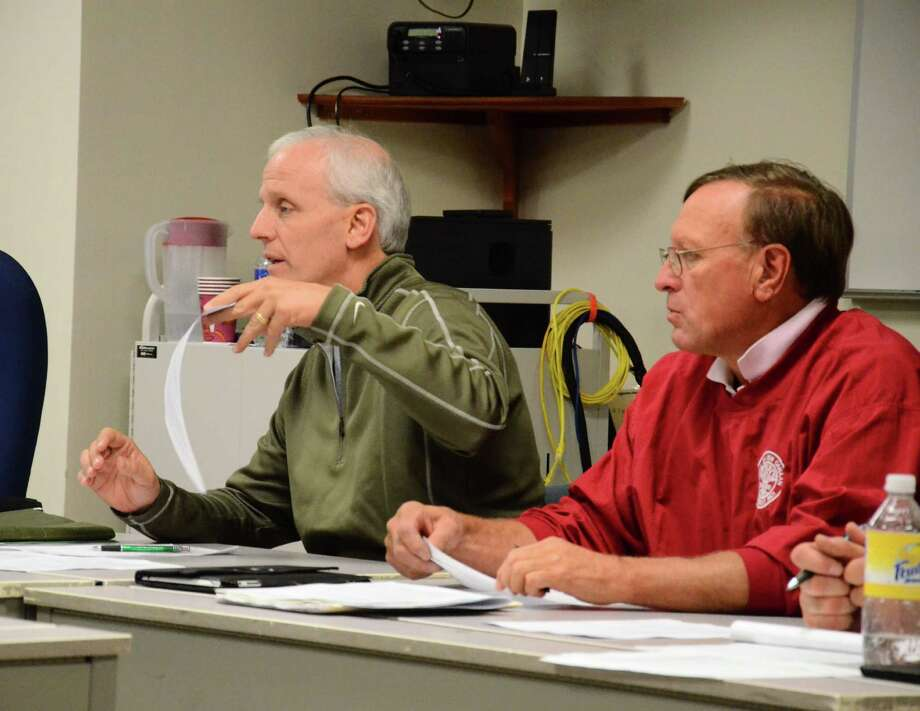 Youth Sports Committee's Chairman Chris Robustelli, left, and ex-officio member Stephen Benko during a meeting Monday, Sept. 15, 2014, at the New Canaan Police Department, New Canaan, Conn. Photo: Nelson Oliveira / New Canaan News