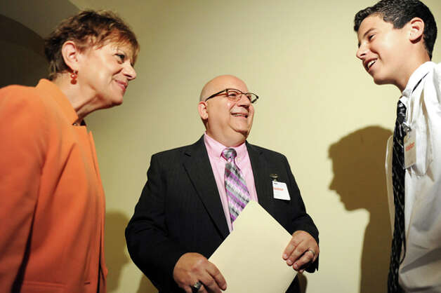 Gloversville High Latin teacher Charles Giglio, New York State Teacher of the Year, center, talks with Catalina Fortino, vice president of NYSUT, left, and Kyle Fonda, 15, one of Giglio's Latin students, on Tuesday, Sept. 16, 2014, at The State Education Building in Albany, N.Y. (Cindy Schultz / Times Union) Photo: Cindy Schultz, Albany Times Union / 10028644A