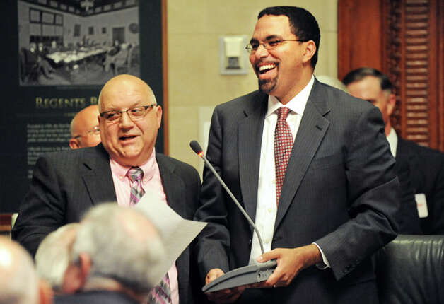 Gloversville High Latin teacher Charles Giglio, left, speaks after receiving the New York State Teacher of the Year award from State Education Commissioner John B. King, Jr., right, on Tuesday, Sept. 16, 2014, at The State Education Building in Albany, N.Y. (Cindy Schultz / Times Union) Photo: Cindy Schultz, Albany Times Union / 10028644A