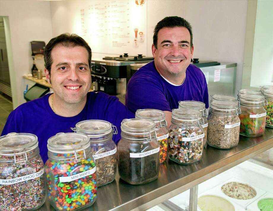 Carmine Tomas, left, and David Judge, right, pose for a photo at Little Monkey Cafe in Stamford, Conn., on Tuesday, September 16, 2014. Photo: Lindsay Perry / Stamford Advocate