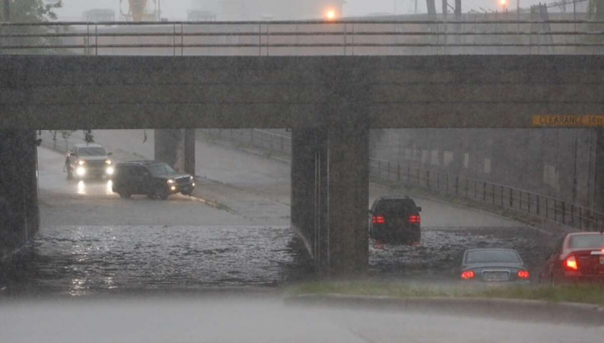 Cars turn around as water rises along Studewood north of Washington on Tuesday, Sept. 16, 2014.