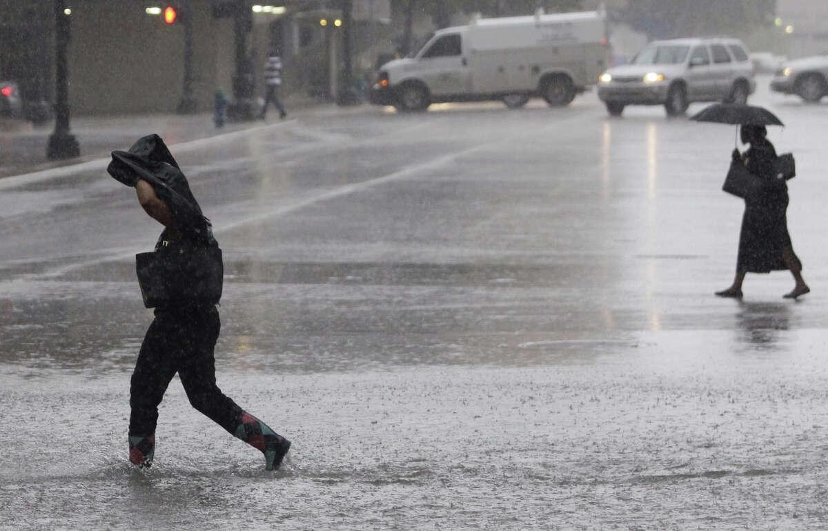 Pedestrians make their way through downtown Tuesday, Sept. 16, 2014.