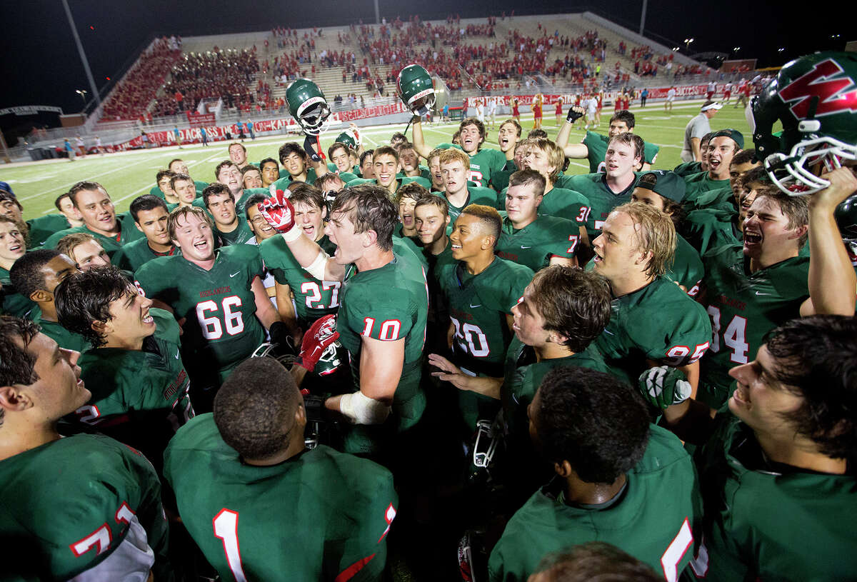 The Woodland High School football team celebrates a 24-7 victory over the Katy Tigers at Woodforest Bank Stadium, Friday, Sept. 12, 2014, in Shenandoah. (Cody Duty / Houston Chronicle)