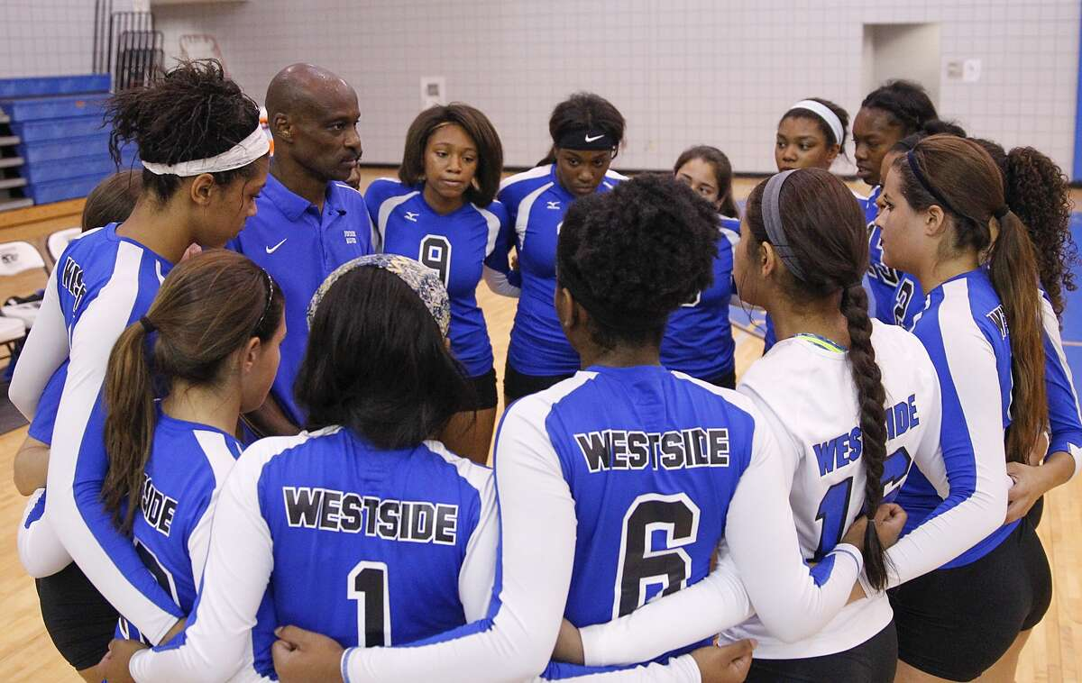 Westside head volleyball coach Andre King gives his team some last second instructions as they took on The Village School in a match at Westside High School on August 12, 2014.
