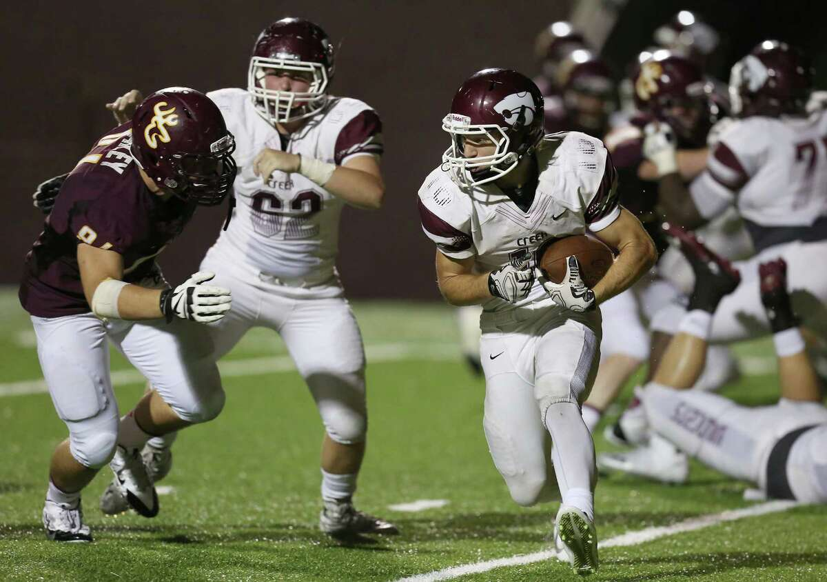 Clear Creek running back Andrew Wiesen, right, is tackled by a Deer Park lineman in a 24-14 Wildcat loss last week.
