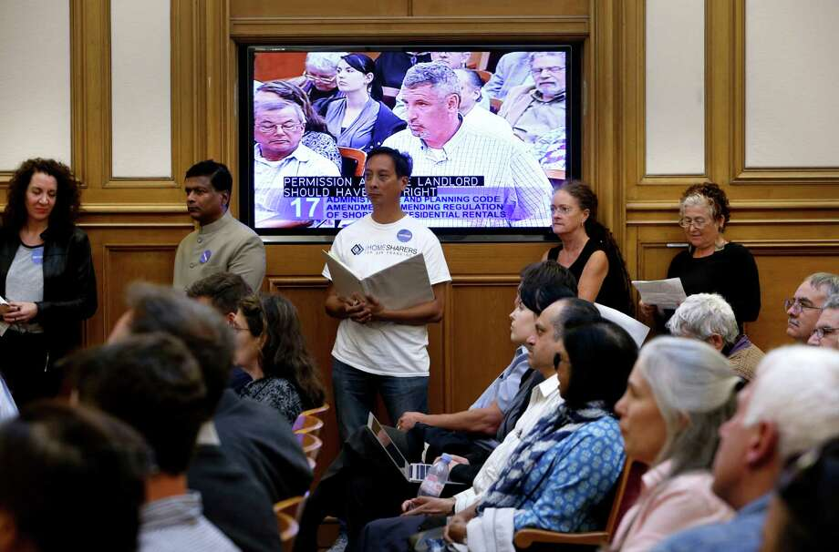 People line up for a chance to speak as the San Francisco planning commission hears public comment to Supervisor David Chiu's proposed Airbnb legislation at their weekly meeting in City Hall on Thursday August 7, 2014, in San Francisco, Calif. Photo: Michael Macor, Staff / The Chronicle / ONLINE_YES