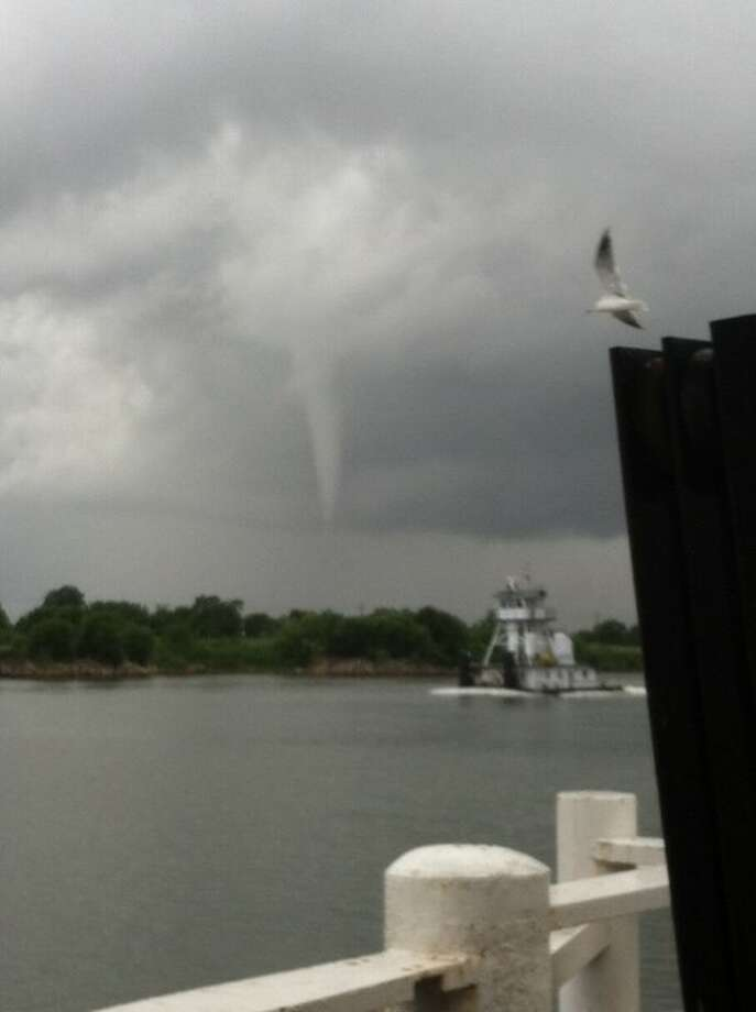 A water spout formed over Sabine Lake on Tuesday. The image of the spout, which is a tornado over water, lasted about 10 minutes after forming around 2 p.m.