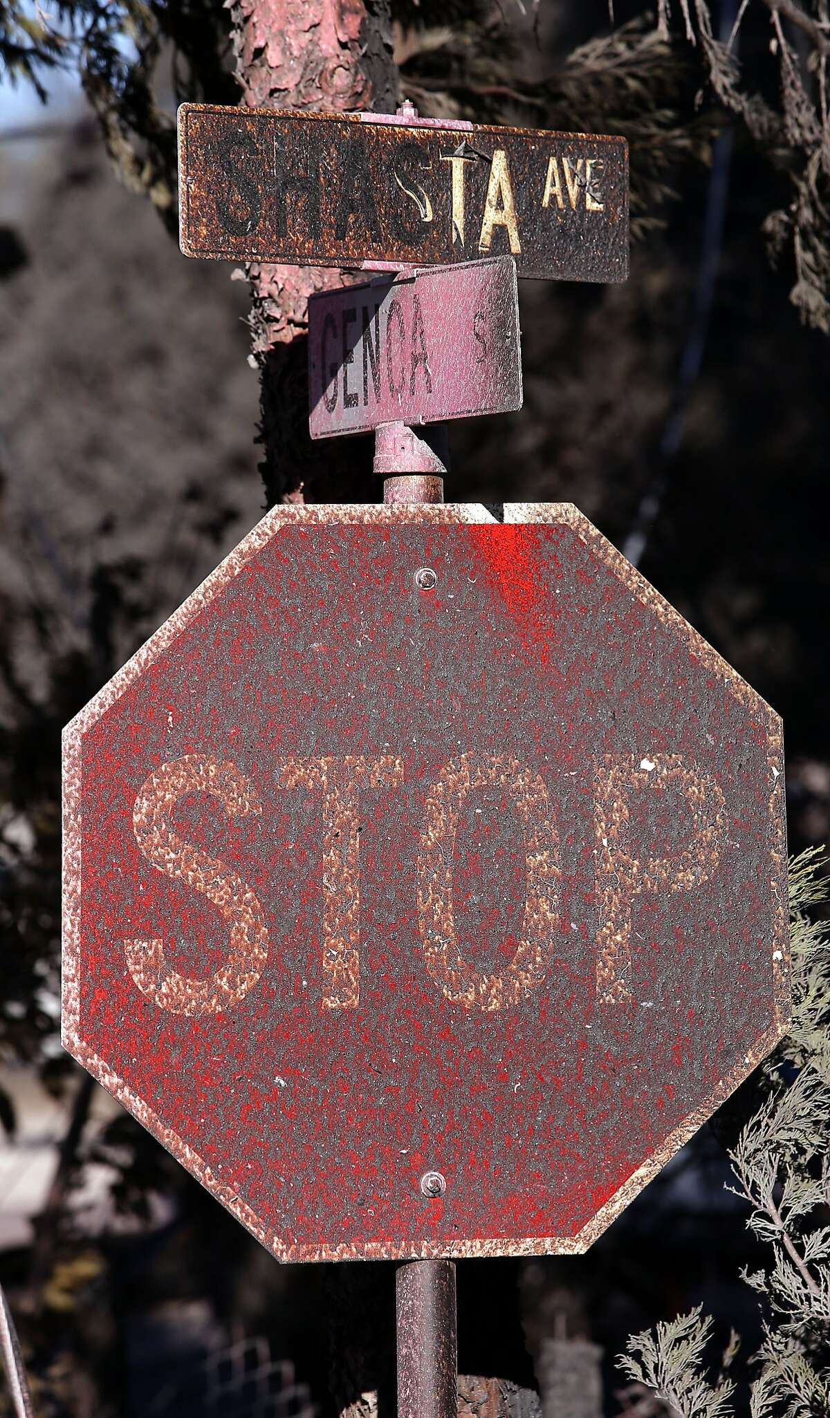 A street sign in a destroyed neighborhood, as fire crews battle the Boles Fire in Weed , Calif., on Tuesday Sept. 16, 2014.
