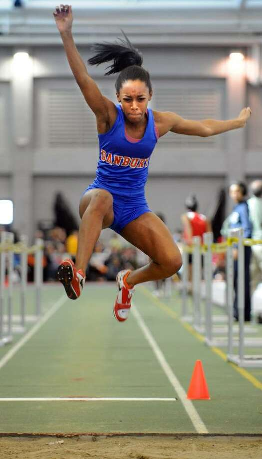Danbury's Maya Walton competes in the long jump event Saturday Feb. 20, 2010 at the CIAC State Championship Indoor Track and Field meet at the New Haven Athletic Center. Photo: Autumn Driscoll / Connecticut Post