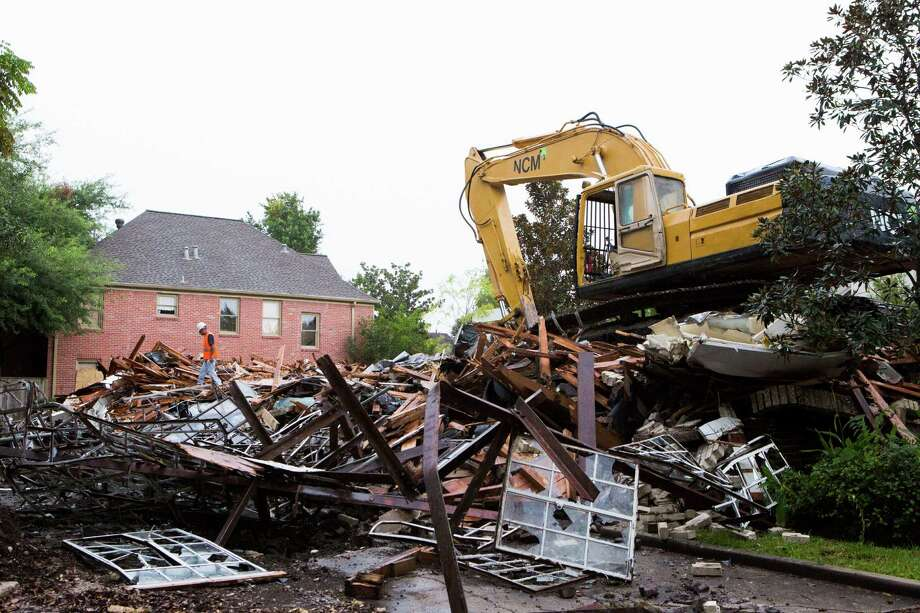 Demolition equipment flattened the Josephine Apartments, near Rice  University, on Tuesday.The complex