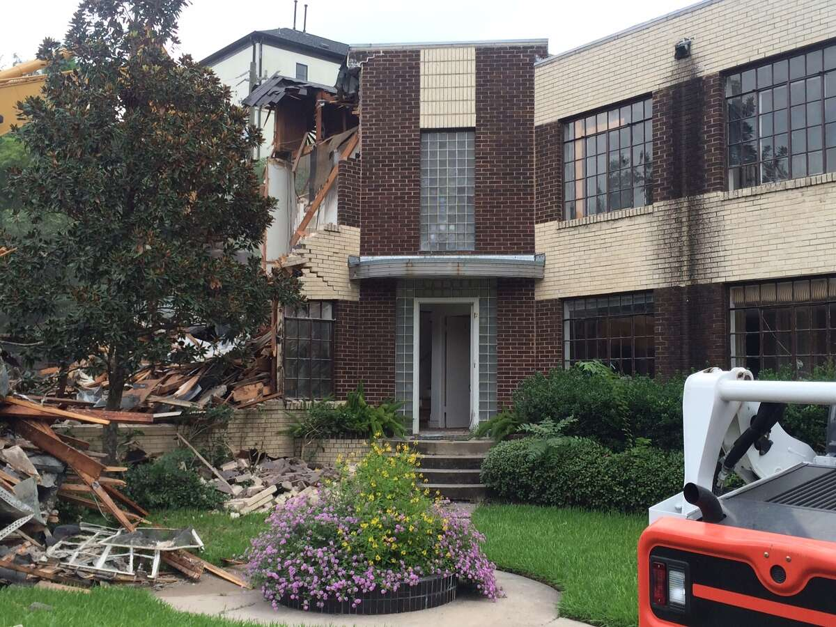 Josephine Apartments at Ashby and Bolsover on Tuesday, Sept. 16. Demolition crews take down the 1930s-era complex to replace with four new townhomes.