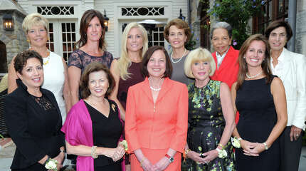 Front row center, Adrienne Singer, president & chief exeuctive officer of the YWCA of Greenwich, with the organization's Spirit Award winners, they are front row, left to right, Sue Moretti Rogers, Bea Crumbine, Singer, Mary Ann Henry, Jill Coyle, at back row left to right, they are, Debbie Black, Elizabeth Boutry, Tiffany Burnette, Cricket Lockhart, Nancy Brown and Lennie de Csepel, during the ceremony at the Greenwich home of Brian and Giovanna Miller, Conyers Farm, Greenwich, Conn., Tuesday night, Sept. 16, 2014. The 10 outstanding women volunteers were honored by the YWCA for their community service.