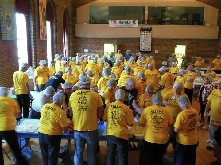 More than 130 volunteers from five local Lutheran congregations donned yellow T-shirts (and hair net