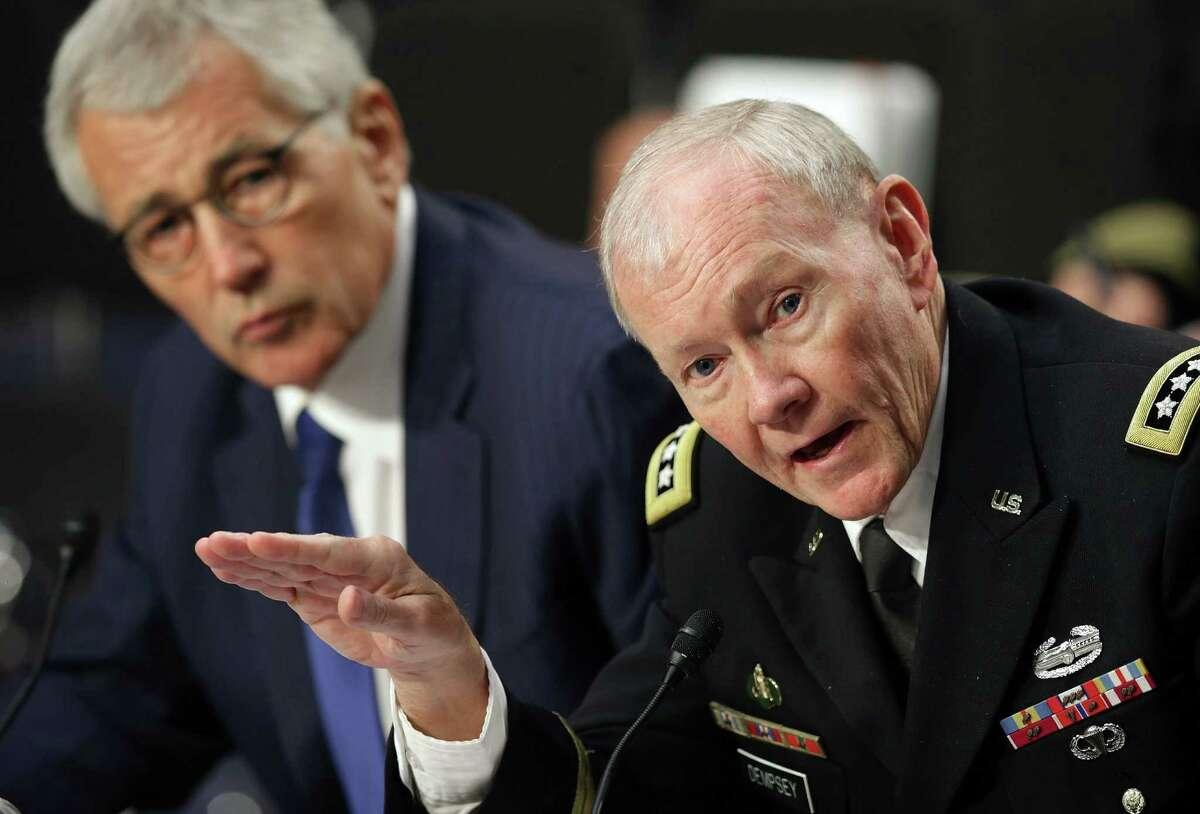 Army Gen. Martin Dempsey (foreground) with Defense Secretary Chuck Hagel.