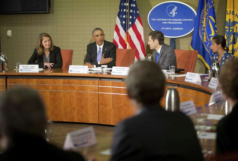 Secretary of Health and Human Services Sylvia Mathews Burwell (from left), President Barack Obama, CDC Director Thomas Frieden and National Security Adviser Susan Rice discuss the response to the Ebola outbreak. Photo: Pablo Martinez Monsivais / Associated Press / AP