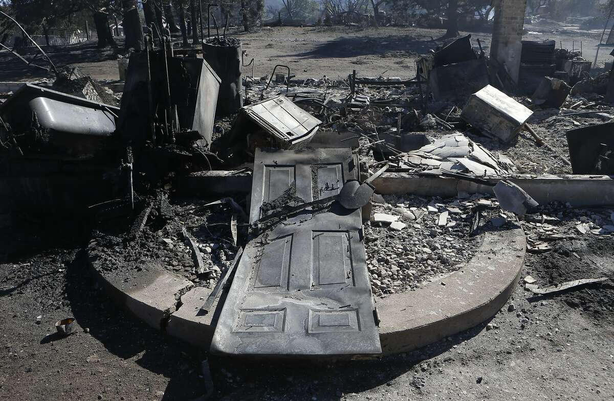 The charred remains of a home as fire crews continue to battle the Boles Fire in Weed , Calif., on Tuesday Sept. 16, 2014, which started yesterday afternoon.