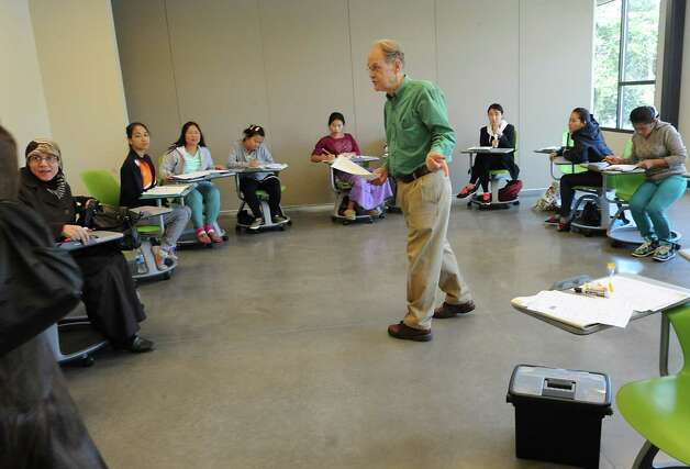 Malcolm Bird, center, teaches an English as a Second Language class at the Capital South Campus Center which is run by the Trinity Alliance of the Capital Region on Tuesday, Sept. 16, 2014 in Albany, N.Y. (Lori Van Buren / Times Union) f Photo: Lori Van Buren / 10028649A
