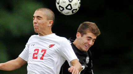Greenwich's Inaki Mendive and Trumbull's Matthew Kapell compete for the header during their soccer game at Greenwich High School on Tuesday, Sept. 16, 2014. Greenwich won, 2-1.