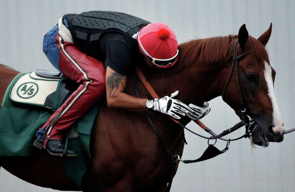Exercise rider Willie Delgado hugs California Chrome during a training session at Los Alamitos Race Course Thursday, Sept. 4, 2014, in Los Alamitos, Calif. California Chrome, the Kentucky Derby and Preakness winner, is scheduled to run in the $1 million Pennsylvania Derby on Sept. 20. (AP Photo/Jae C. Hong) ORG XMIT: CAJH101