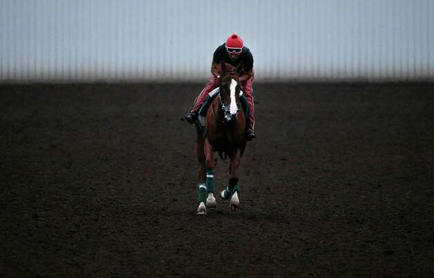 Exercise rider Willie Delgado rides California Chrome along the track during a morning training session at Los Alamitos Race Course Thursday, Sept. 4, 2014, in Los Alamitos, Calif. California Chrome, the Kentucky Derby and Preakness winner, is scheduled to run in the $1 million Pennsylvania Derby on Sept. 20. (AP Photo/Jae C. Hong) ORG XMIT: CAJH102 Photo: Jae C. Hong / AP