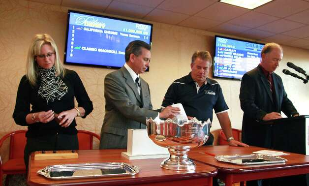 This photo released by Equi-Photo shows racing officials at Parx Racing in Bensalem, Pennsylvania, from left to right,  Wendi Graham, Lou Santoro, Sal Sinatra, Director Of Racing and Announcer Keith Jones draw Post Positions on Monday, Sept. 15, 2014,  for Saturday's $1,000,000 Pennsylvania Derby at Parx. Kentucky Derby and Preakness Stakes Champion California Chrome drew the #1 Post and is the Morning Line Favorite at odds of 1 to 1.  (AP Photo/EQUI-PHOTO,Bill Denver) ORG XMIT: PPR101 Photo: Bill Denver / /EQUI-PHOTO