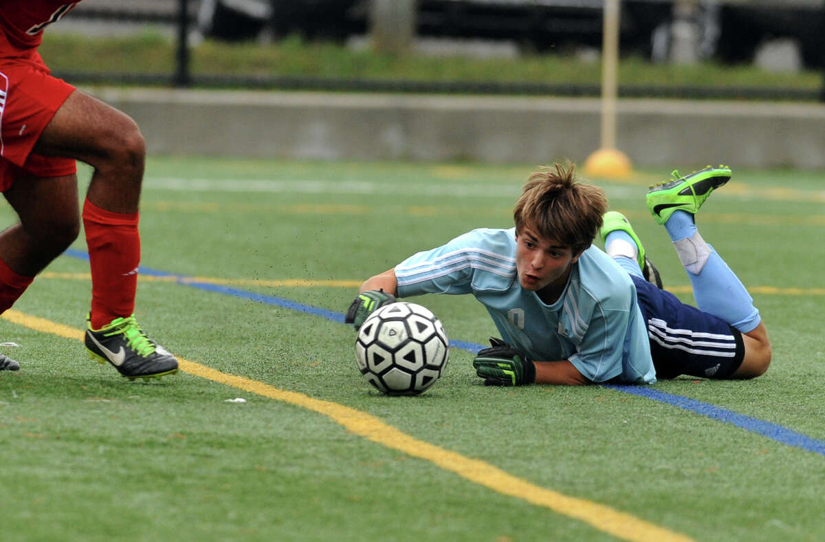 New Canaan goalie Griffin Paterson, during boys soccer action against New Canaan in Stamford, Conn., on Tuesday Sept. 16, 2014.
