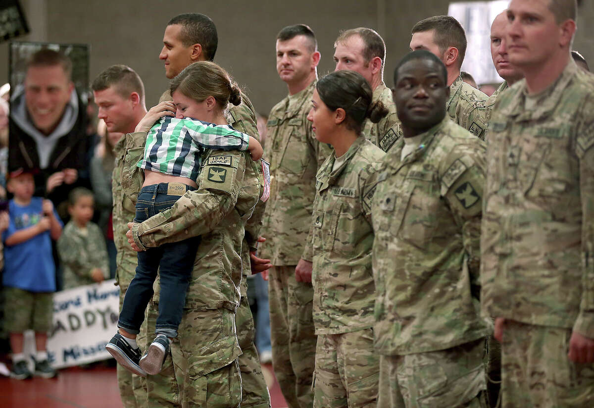 Kathryn Waldvogel, got a warm welcome from her son Cooper, 3, after her return from Afghanistan at the Inver Grove Heights Training Center, Tuesday, Sept. 16, 2014 in Inver Grove Heights, Minn.