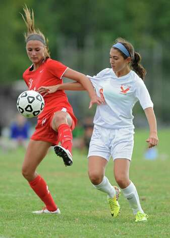 Niskayuna's Marika Contompasis battles for the ball with Bethlehem's Grace Hotaling during a soccer game on Tuesday, Sept. 16, 2014 in Delmar, N.Y. (Lori Van Buren / Times Union) Photo: Lori Van Buren / 00028610A
